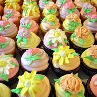 Wedding Cupcakes Wedding cupcakes featuring an assortment of buttercream fantasy flowers.