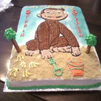 Curious George The Monkey   The picture was traced by hand onto the cake and filled in with BC frosting.