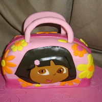 Dora The Explorer Purse Cake Vanilla cake with dulce de leche filling.