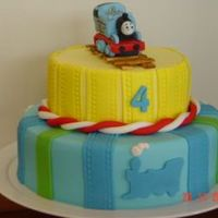 Thomas The Train Engine Cake Dummy cake covered in fondant. Thomas was made in gumpaste. I made this cake for my 4 year old son. He adores Thomas. I plan on making a...