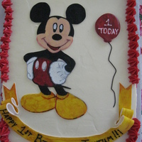 Taytum's Mickey Cake Strawberry cake with vanilla BC. Mickey, ribbon, and balloon are fondant.