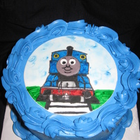 Nehemiah's Thomas The Train Vanilla cake with cookies and cream filling, blue Vanilla Buttercream, and a Thomas fondant scene.