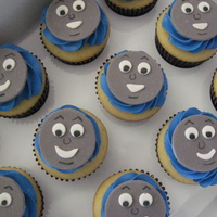 Thomas Cupcakes Vanilla cupcakes filled with cookies and cream buttercream, blue Vanilla buttercream, and a fondant Thomas face..