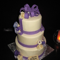 De Maris's Birthday Cake Cake is all red velvet, and all covered in mmf, purple ribbon is wilton fondant. Bow is wilton fondant with tylose, flowers are wilton...