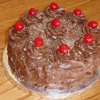 Black Forest Cake....  I made this devil's food cake with cherry pie filling and milk choc. frosting with cherries and choc. shavings on top for my Grandma&#...