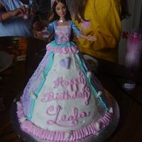 Barbie Cake I made this cake for a 5 yr. old using a Barbie the parents had bought for their daughter. Sorry the picture isn't better.