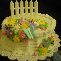 First Time With Color Flow  This is the first cake I did with color flow and royal icing. It was so hot that day that my border and basketweaving were falling off! I...