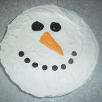 Snowman  The 2nd cake i made for the christmas party, Cute little snowman. Wanted something simple due to time reasons. Egg Nog cake with Egg nog...