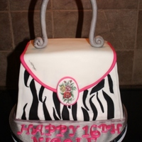 Ed Hardy Bag White cake strawberry fill buttercream icing, fondant and gumpaste accents