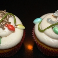 Lighted Boat Parade Cupcakes Pumpkin cupcake cream cheese icing fondant wheel ,anchor and lights