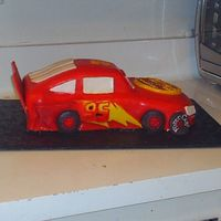 Cars Side View This was my first attempt at a cars cake. I really learned a lot making this one hope it looks ok. I used bc and mmf and royal icing.