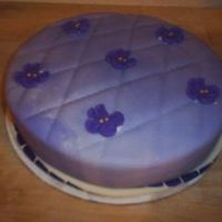 Violet Baby Shower Cake Made a mini cake for a baby shower theme was purple and violets.I marbled the fondant with purple and white and the violet flowers are...