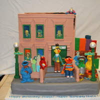 123 Sesame Street I will NEVER.EVER.EVER make a building again. I made the panels two weeks ahead of time with fondant/gumpaste. They must have shrunk or...
