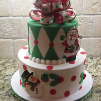 Holly Christmas  This cake was done for my daughter's Christmas party at school. The cake was done in buttercream with fondant accents. The snowman,...
