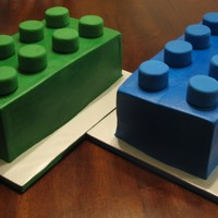 Lego Blocks I did these cakesfor two little boys who were having their Lego themed birthday party together. One block for each birthday boy. Cakes done...