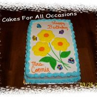 Spring Flowers I made this cake for my son's first grade teachers birthday today. She sure was surprised.Made with buttercream icing cookie cutter...