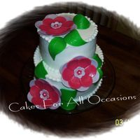 2 Tier Cake Made rolled fondant flowers and leaves, buttercream icing, tear drop border.