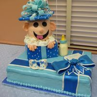 Baby Shower Present  The cake is covered in a combination of BC and MMF. Bows and booties are gumpaste. It was a lot of fun to make and Iâm told the...