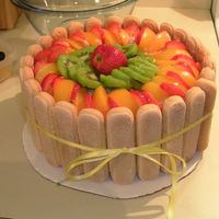 Charlota Cake This is a cake ive been making with my mom for yeaaaaars!!!!!Is vanilla cake from scratch strawberry filling, fresh fruits and lady fingers...