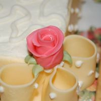 Duff Rose Sheet Cake Border This is a bridal shower cake using white chocolate fondant strips for the ribbon and bow loops going all around the sheet cake. Roses are...