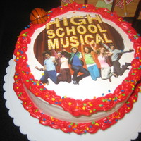 "High School Musical Cake 2 8"" rounds frosted in BC with an edible image and a fondant basketball."