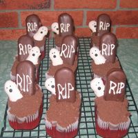 Grave Cupcakes I made these for Halloween. They are red velvet cake baked in the mini loaf pan frosted with chocolate frosting and topped with crushed...