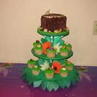 Tinkerbell Cake This is a tinkerbell cupcake tower with a tree stump on top.