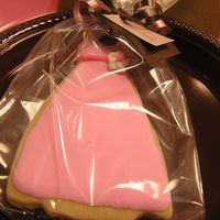 Dress Cookies Made to match bridal shower invitations. Goes along with cake/cupcake in gallary. These were used as placecards and the were gifts.