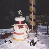 Cake2.jpg   Outside wedding and First fondant covered cake.