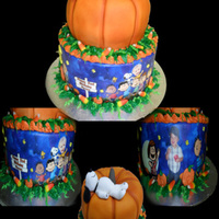 Charlie Brown And The Pumpkin Patch  Did this for a friend of mine. My first pumpkin cake :) I was happy with it. The bottom tier was just buttercream iced and then wrapped in...