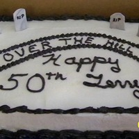 Over The Hill Chocolate Fudge Cake w/bc frosting and fondant headstones.