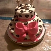 Leopard Cake Red velvet cake covered and filled with cream cheese icing and fondant