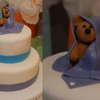 Baby Boy Bear Shower Cake the Bear us made out of gumpaste & the blanket out of MMF. the mommy to be loved him so much she kept him for the baby's room :)