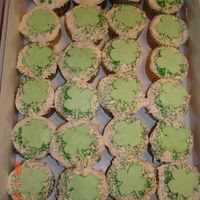 St. Patrick's Day Cupcakes Just plain vanilla cupcakes and store bought icing with royal icing shamrocks.