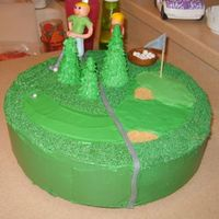 Golf Cake My kids made the figures of my and dad out of fondant