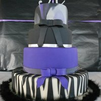 Sweet 16 Purple Black Silver This is a sweet 16 cake - two of the tiers are fake but I truly belive this is the best cake I have made - it just all went perfect.