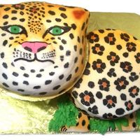 "Leopard Cake This is a 9"" and Animal crackers pan, both WASC. The color was airbrushed on, and then the spots were hand-painted on with black food..."