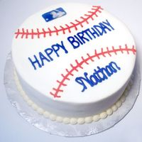"Baseball Cake This is just a simple 8"" round CASC made to look like a baseball. All bc except logo which is a chocolate transfer"