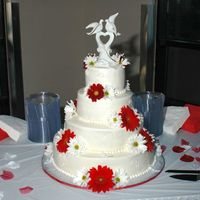 Red Daisy Wedding This is my latest wedding cake, a 4 tier round (16, 12, 9. 6) all BC with BC scrollwork and fresh flowers. Each cake was a different flavor...