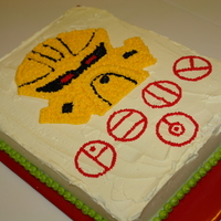 Lego Bionicle Dekar Mask Cake My son wanted one of his beloved Lego Bionicle's mask made into a cake. He handed me the tiny yellow mask of Mahri Nui Matoran Dekar....