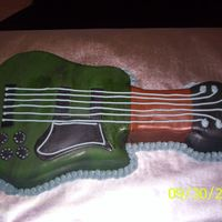 Picture_018.jpg Groom's guitar cake. Chocolate fudge cake covered in all fondant.
