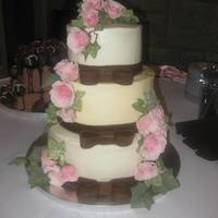 Round Wedding Cake 3 tier, iced in BC w/ fondant bows and fresh roses