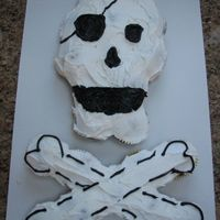 Pirate Skull & Crossbones Cupcake Cake For my son's school pirate party. Uses about 21 cupcakes.