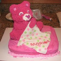 Care Bear Baby Shower Cake 3D cake for a Care Bear themed Baby shower. I used the Wilton 3D cake pan and fondant for the blanket.