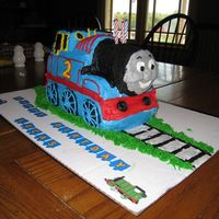 Thomas The Train 3D Cake Made this cake for my son's 2nd birthday. Baked cake in loaf pans and cut to shape. He was so excited to eat Thomas' face!