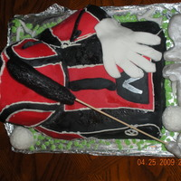 Golf Bag i use a 13x9 cake carved to size then a half ball is the front pocket, I used scraps of cake where i craved to make side pocket. I then...
