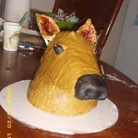 Deer I used 2 round cakes and a football shaped cake. I carved all to make neck and head. the head is on covered board. supported by wooden...