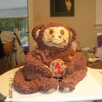 Monkey Cake monkey cake was made with 3-d bear cake pan he is covered in buttercream. His arms legs and tail are fondant. Holding a cookie. the...