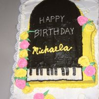 Dscf0305.jpg Made this one for my office manager's daughter. Piano is choc. cake with choc. BC, bottom is yellow cake with raspberry mouse filliing...