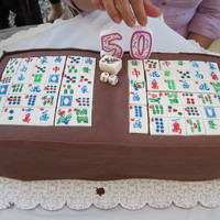 "Mahjong Cake Chocolate Fondant w/ chocolate buttercream filling. Family put the ""50"" candle so she had something to blow out :)"